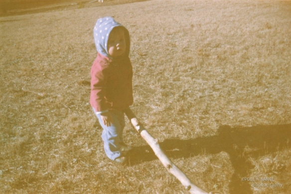 Adeline and a Giant Stick. Film photograph. Polly Nance. 2012.