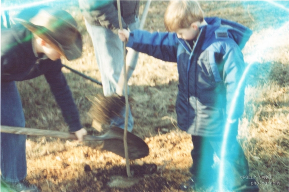 Cousins Planting Trees Together. Film photograph. Polly Nance. 2012.